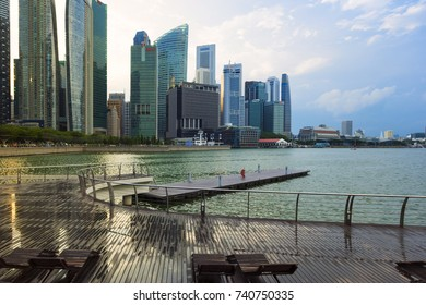 SINGAPORE, MARCH 25 2017 : Panorama of Singapore and reflection cityscape with Modern building around Marina bay at dusk
