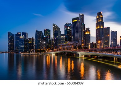Singapore - March 25, 2017: Singapore skyline dusk and illuminated financial district night view, Downtown Urban cityscape of Singapore. Modern skyscrapers of business district Marina Bay