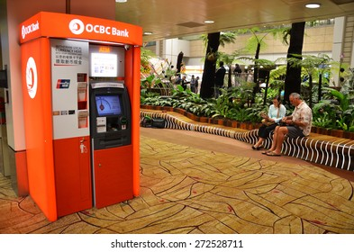 SINGAPORE - MARCH 26, 2015: OCBC ATM machine located in the Changi airport in Singapore on March 26, 2015. The OCBC Bank is a publicly listed financial services organisation in Singapore