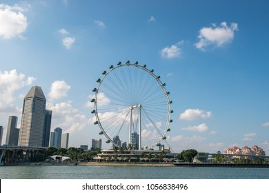 SINGAPORE, MARCH 27,2017 : Singapore flyer's cabin and city view with cloudy sky background.The Singapore Flyer is a giant Ferris wheel in Singapore.