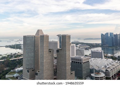 Singapore, Singapore - March 29 2021: Singapore city skyline with clear sky at sunset