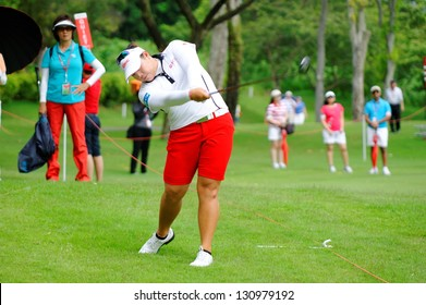 SINGAPORE - MARCH 3: Ariya Jutanugarn from Thailand striking the ball during HSBC Women's Champions at Sentosa Golf Club Serapong Course March 3, 2013 in Singapore
