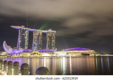 SINGAPORE - MARCH 3: Marina Bay Sands hotel at night on March 3, 2017 in Singapore. Wonderful show is the largest light and water spectacle in Southeast Asia