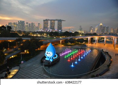 Singapore - March 31 : Evening view of city skyline with colourful water fountain taken from Marina Barrage on March 31, 2017.