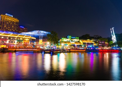 SINGAPORE - MARCH 5 : Colorful light building at night in Clarke Quay, Singapore on March 5, 2015. Clarke Quay, is a historical riverside quay in Singapore, located within the Singapore River Area.
