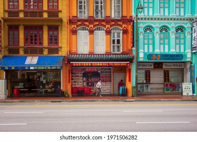 Singapore - March 6, 2021: Colourful shophouses in Singapore's Chinatown have been converted into shops, restaurants and hotels but have retained their distinctive colours and designs.