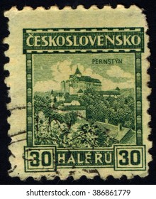 SINGAPORE - MARCH 7, 2016: A stamp printed in Czechoslovakia shows Pernstejn Castle, circa 1926