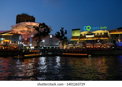 SINGAPORE - March 7, 2019 : Colorful light building at night in Clarke Quay, Singapore. Clarke Quay, is a historical riverside quay in Singapore.