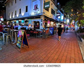 Singapore, Singapore- March 7, 2019:Night view of Boat Quay shop houses. Boat Quay is a historical quay in Singapore which is situated upstream from the mouth of Singapore River on its southern bank.