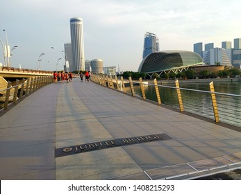 Singapore, Singapore- March 8, 2019: Jubilee Bridge at Singapore Waterfront. Jubilee Bridge has been built across the Singapore River to mark Singapore's Golden Jubilee in 2015 (SG50).