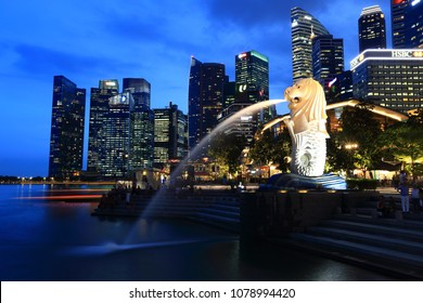 Singapore, Singapore - March 9, 2018: Sunrset at Merlion and Singapore city skyline with Singapore Flyer