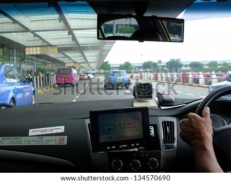 SINGAPORE MARCH 9 Taxi Driver Arriving Stock Photo Edit Now