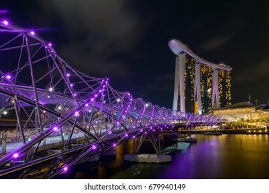 Singapore Marina bay, August 27, 2015: Beautiful purple lit Helix bridge in Marina bay of Singapore during evening
