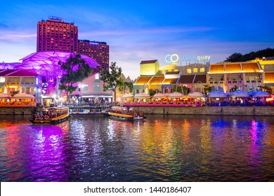SINGAPORE - MAY 09, 2019: Colorful light illuminated Clarke Quay at night. Clarke Quay is very popular for nightlife in Singapore.