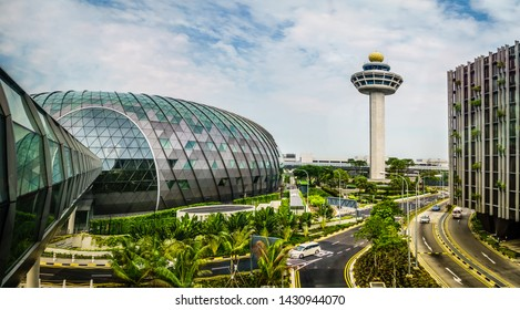 Singapore - May 1,  2019: Exterior view of Jewel and Control Tower. Jewel Changi Airport is a mixed-use development at Changi Airport in Singapore, opened in April 2019.