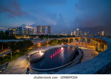 Singapore - May 10, 2018:  Sunset at Marina Bay Singapore city skyline, as seen from Marina Barrage.