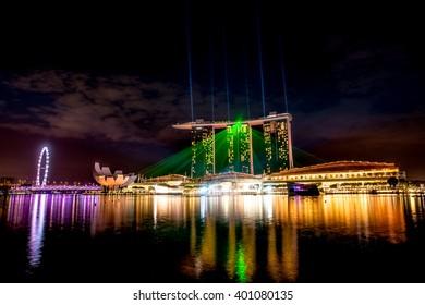 SINGAPORE -MAY 10: Wonderful laser show at the Marina Bay waterfront in Singapore. Marina Bay Sands Hotel dominates the skyline at Marina Bay on May 10, 2014