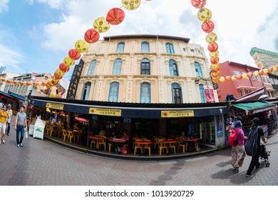 SINGAPORE - MAY 11, 2017: Chinatown with notable Chinese buildings, restaurants and decoration. Many tourists find there authentic food, clothes and other stuff and people engaging in daily activity.