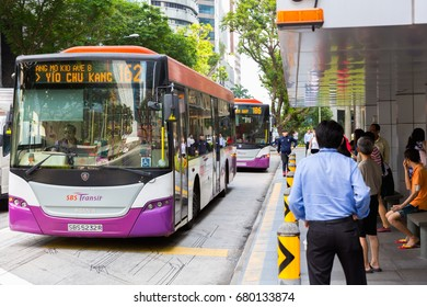 SINGAPORE, MAY 11, 2017 : The city bus arrives at the station. Public transport in the city Singapore.