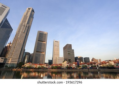 SINGAPORE - May 11: Singapore River with the skyline of Raffles Place at the morning on May 11, 2014 in Singapore. Singapore River is a river near Central Area in the southern part of Singapore