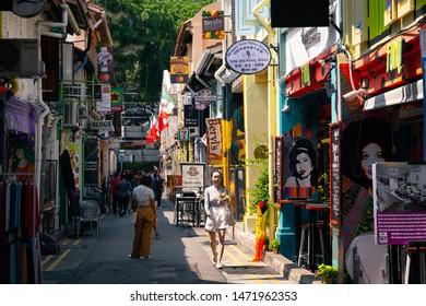 SINGAPORE - MAY 12, 2019: Tourist at Haji Lane in Singapore. Haji Lane is the famous boutique shopping lane in Singapore.
