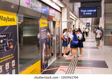 SINGAPORE - MAY 13, 2017:Passengers waiting for train arrival in MRT station in Singapore. The MRT has 102 stations & is the second-oldest metro system in Southeast Asia, after Manila's LRT.