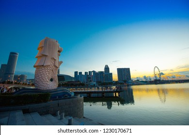 SINGAPORE - MAY 13: The Merlion fountain in front of the Marina Bay Sands hotel on May 13, 2017 in Singapore. Merlion is a imaginary creature with the head of a lion, seen as a symbol of Singapore