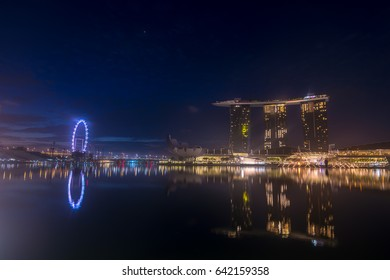 SINGAPORE MAY 14 2017 : Helix bridge Marina Bay Sand Singapore Flyer and Artscince Museum it's most popular place of tourist at merlion park and marina bay reflected in water dawn before sunrise