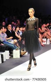 SINGAPORE - MAY 14: Model walks down the runway, showcasing designs by Swarovski at Audi Fashion Festival 2011 Swarovski Show on May 14, 2011 in Singapore.