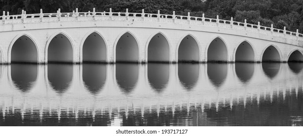 SINGAPORE - MAY 15, 2014: A bridge with a reflection on the water in Singapore Chinese Garden