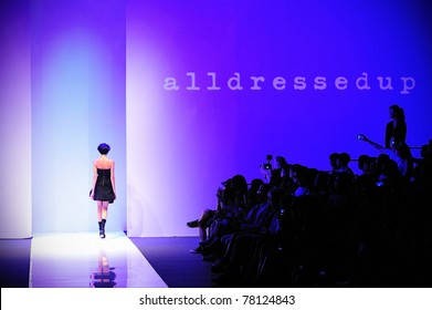 SINGAPORE - MAY 17: Model walking towards backstage, showcasing designs by alldressedup at Audi Fashion Festival 2011 alldressedup Show on May 17, 2011 in Singapore.