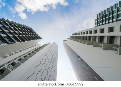 Singapore, Singapore - May 18, 2016 :Low Angle view of high rise residential building in Singapore in a new estate at Hougang Capeview taken on May 18, 2016