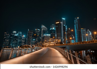 SINGAPORE - MAY 19, 2019: Jubillee Bridge that spans across the Singapore River in the Downtown by night.