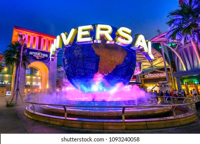 Singapore - May 2, 2018: Universal Studios with luminous globe in Sentosa island at blue hour with pink lights. Universal Studios Singapore is southeast Asia's first Hollywood movie theme park.