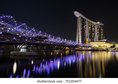 SINGAPORE - MAY 2015, Marina Bay and Helix Bridge is a one of world iconic building containing luxury shop, hotel and casino. located on seaside downtown Singapore.