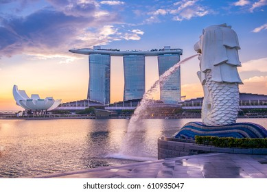 singapore, singapore - May 21, 2016: sunrise at the marina in singapore with the iconic building, merlion