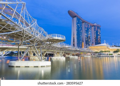 SINGAPORE, MAY 23: Helix Bridge and Marina Bay Sands during twilight with water reflection, famous touristic attractions of Singapore, on May 23, 2015 in Singapore