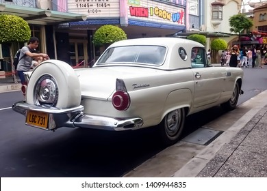 Singapore - May 25, 2019: Ford thunderbird 1957 in white color parked on the street. Right back side view