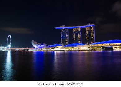Singapore - MAY 29, 2017: Marina Bay Hotel at night in Singapore. Singapore is one of the most popular travel destinations in the world