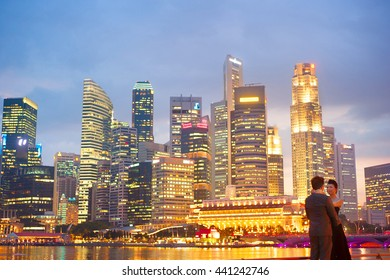 SINGAPORE - MAY 3, 2012: Unidentified people in front of Singapore downtown. population of Singapore is 5.18 million people, of whom 3.25 million (63%) are citizens