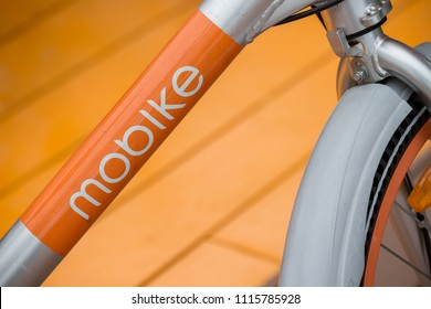 SINGAPORE - MAY 30, 2018_Detail of logo on Mobike parked on footpath in Singapore.