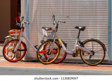 SINGAPORE - MAY 30, 2018_Mobike parked on footpath in Chinatown, Singapore. Mobike is a bike sharing service that you can pick up and leave a bike wherever you need to go.