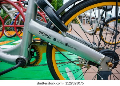 SINGAPORE - MAY 30, 2018_oBike, App Store and Google Play logos on sharing bike parked on footpath in Singapore