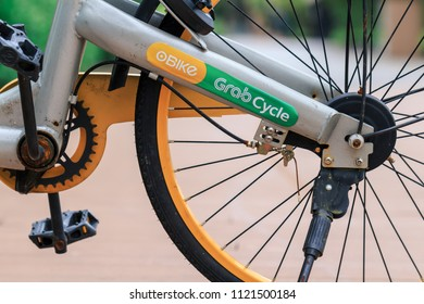 SINGAPORE - MAY 30, 2018_oBike and GrabCycle logo on sharing bike parked on footpath in Singapore. GrabCycle is Grab and oBike co-branding, provide a bike sharing service in Singapore.