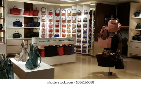 SINGAPORE, SINGAPORE - MAY 4, 2018: LONGCHAMP duty free shop in Changi Airport, Terminal 2, which has fashion and wearable collection of apparel, shoes and bags.