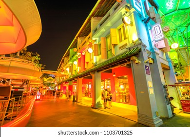 Singapore - May 5, 2018: street view of Clarke Quay with lights and clubs in historic riverside quay, famous for nightclubs and nightlife. Night scene of colorful buildings.