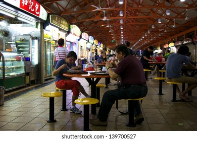 SINGAPORE - MAY 5 - Locals eat at a popular food hall on May 5, 2013 in Chinatown, Singapore.  Inexpensive food stalls are numerous in the city so most Singaporeans dine out at least once a day.