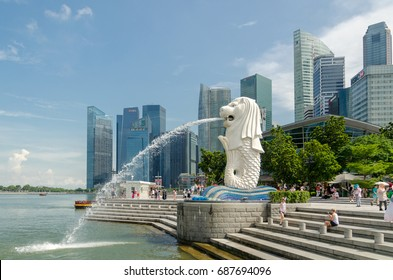 SINGAPORE, SINGAPORE - MAY 5 : Merlion statue fountain with tourist in Merlion Park at Day light summer on May 5, 2017. Merlion fountain is one of the most famous tourist attraction in Singapore.
