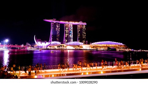 SINGAPORE - May 6, 2017: Nighttime panorama across the Singapore bay featuring the Marina Bay Sands luxury hotel, shopping mall and casino.