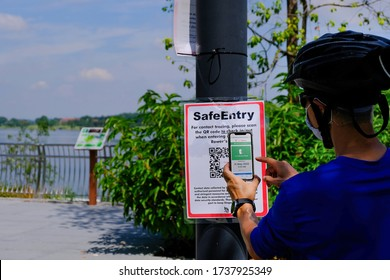 Singapore May2020 COVID-19 Man at Rower's Bay park scanning QR code via SafeEntry, a digital contact tracing tool (check-in system developed developed by GovTech). circuit breaker coronavirus outbreak